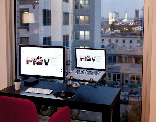 apple cinema and macbook pro with a view