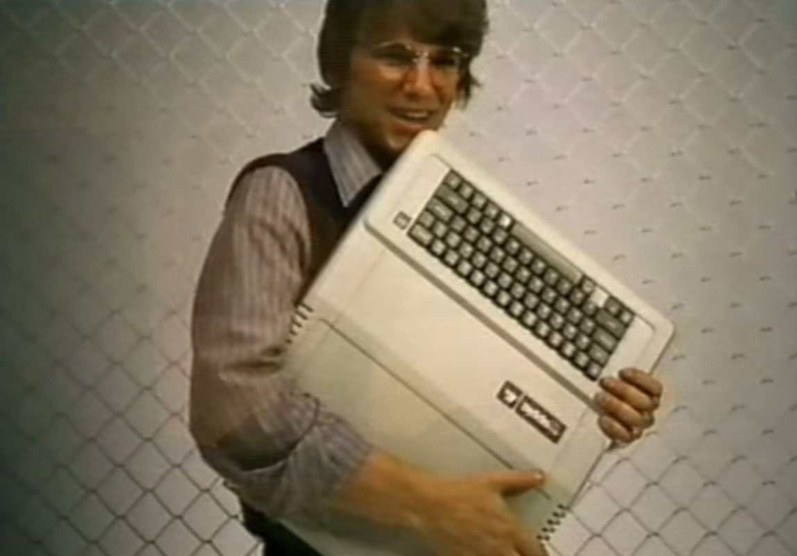 Guy hugging an Apple Computer from 1980s Flashdance sales video, amazing