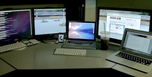 Many Macs at a desk