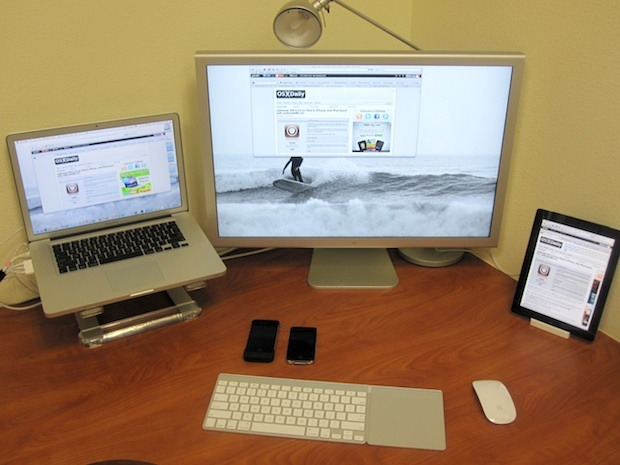 MacBook Pro, an Apple Cinema Display, and an iPad