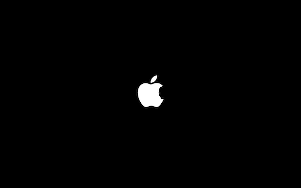 Steve Jobs silhouette within the Apple logo