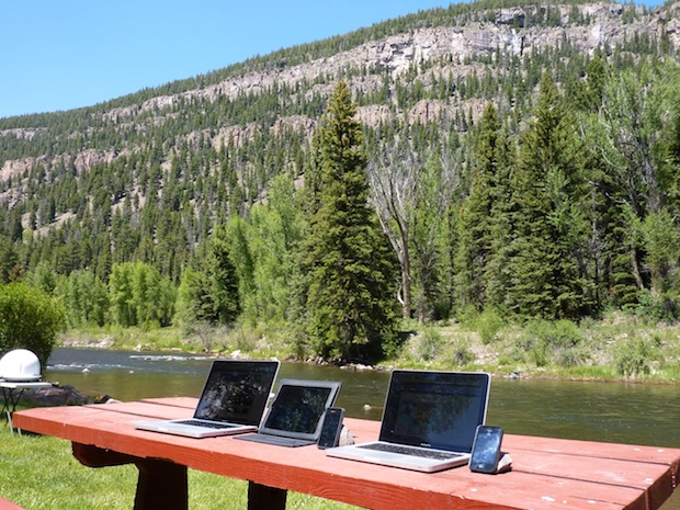 Macs, riverside, at a campground. We're jealous.