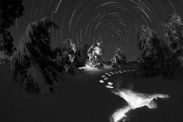 Snow and star trail at night