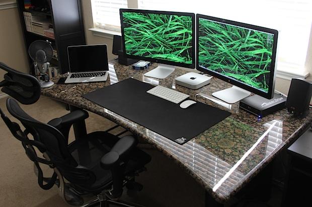 "Mac Mini with dual Thunderbolt 27"" Displays and a MacBook Pro Retina desk setup"