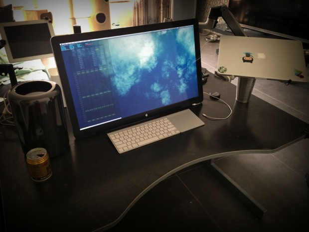 Mac Pro workstation with a Cinema Display attached to swivel