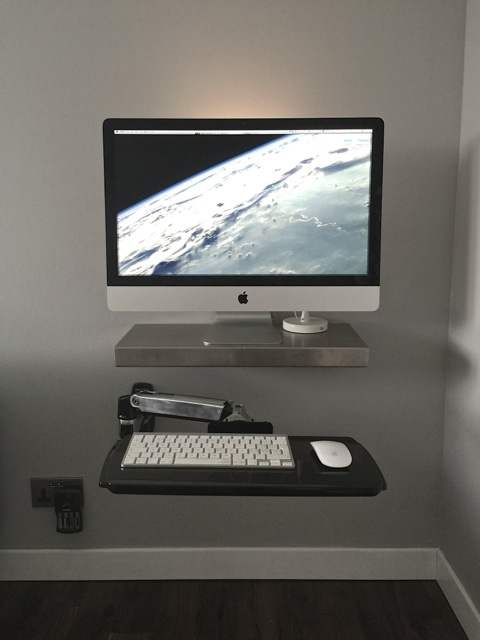 Minimalist iMac wall workstation with articulated shelf