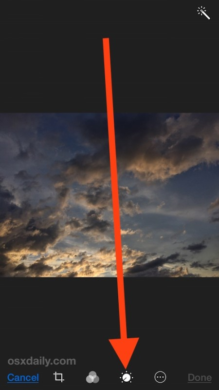 Choose the color and contrast editor button in iOS Photos app