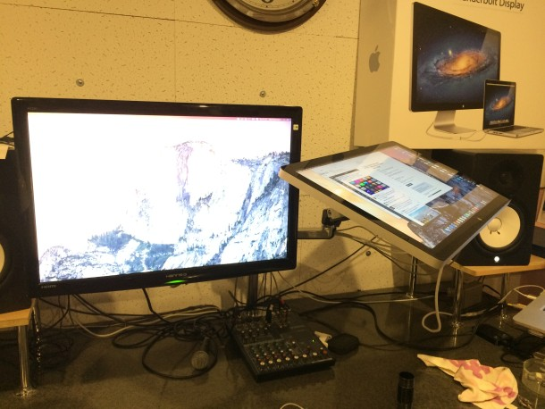 Music Producer Mac setup with swivel displays