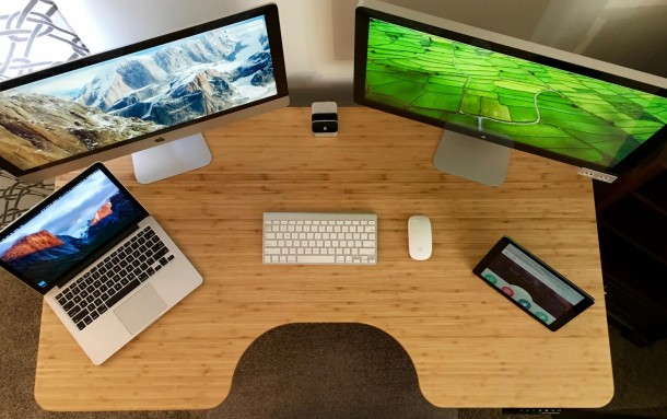Adjustable desk Mac setup of CEO