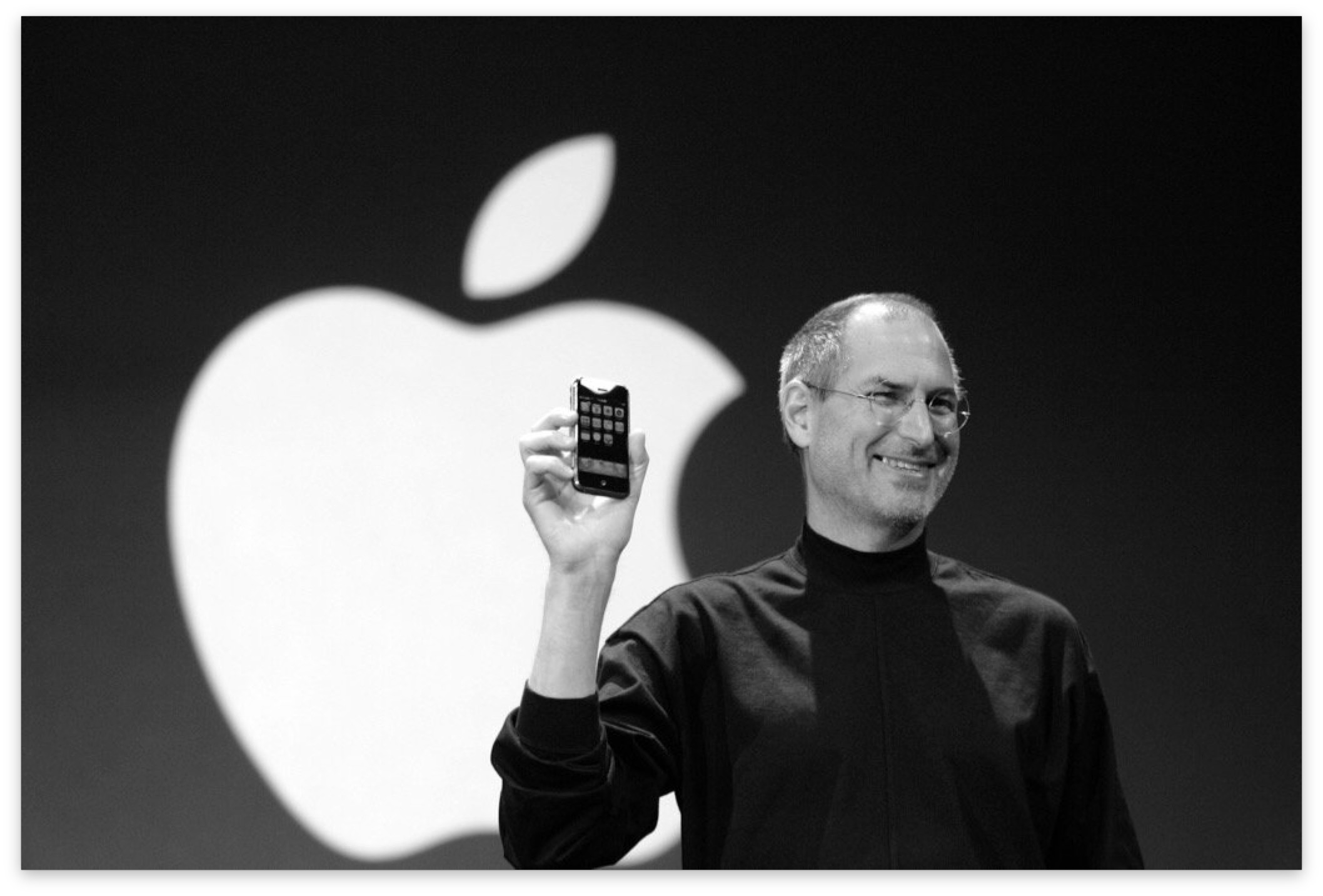 Steve Jobs showing original iPhone on stage
