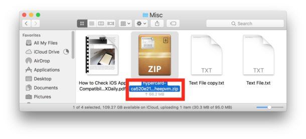 iCloud Drive file upload status shown under icons in the Finder