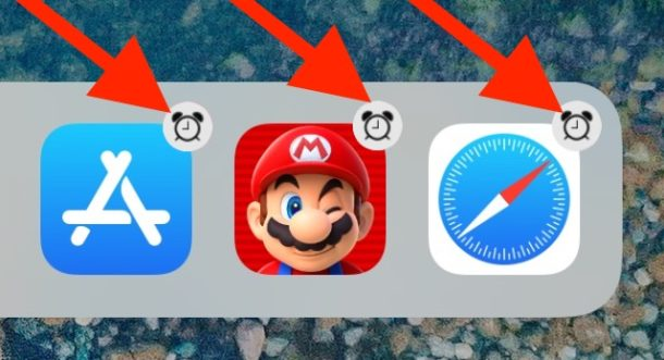 iPad Dock app icons with an alarm clock badge icon on them